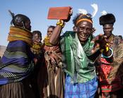 Kenya elder dancing in traditional dress at Lake Turkana