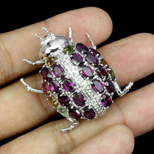 Серебряная брошь  родолитом жук