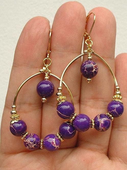 Серьги позолоченны ручной работы с фиолетовой морской яшмой натур.(длина 4.4 см)