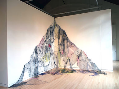 large site specific art gallery installation made from nets and fibers