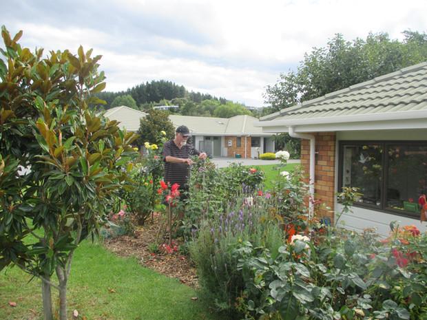 Willson Gardens pruning roses.JPG