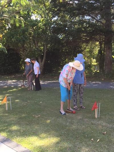 Enjoying a game of Croquet
