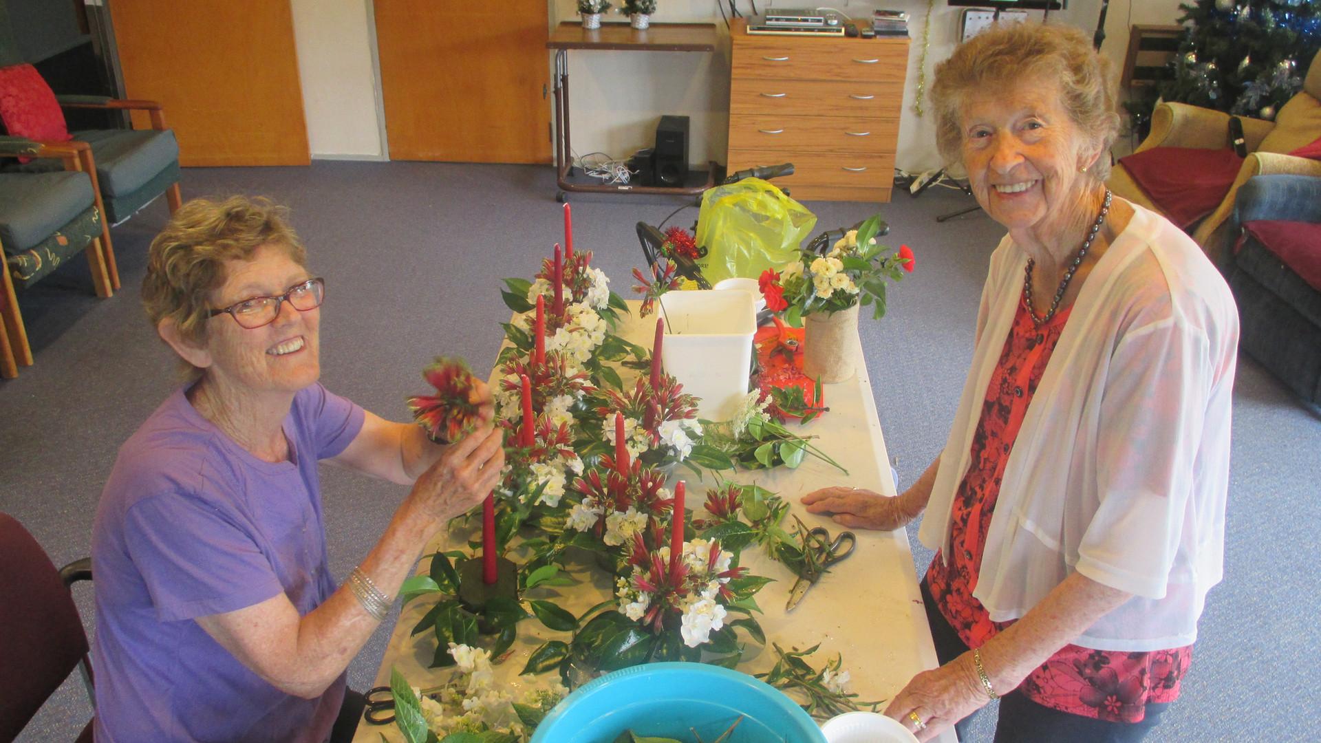 Chris & Dorothy making Christmas table decorations