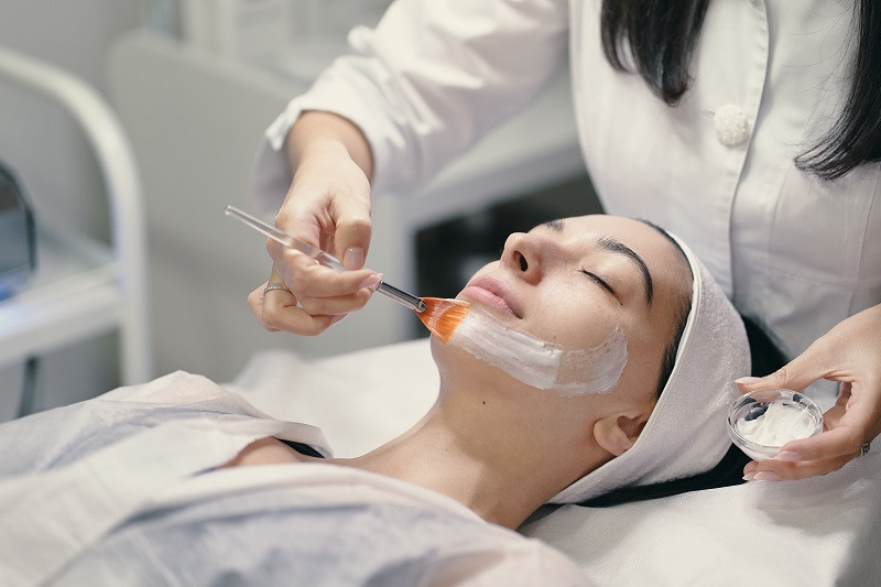 Woman with skincare specialist