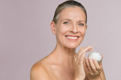 Lady with Facial Moisturizer best cosmetology schools in Orlando fl