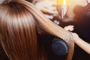 cosmetology hair school orlando fl Woman Blow Drying Hair