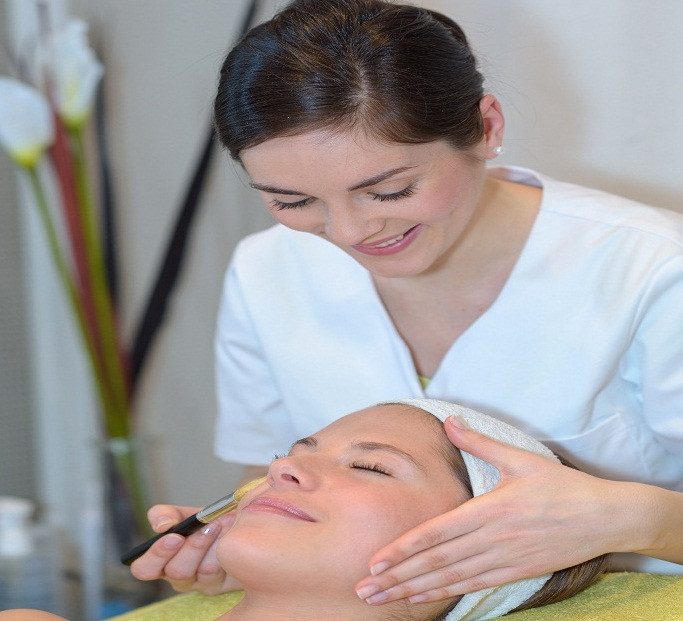 Esthetician with patient