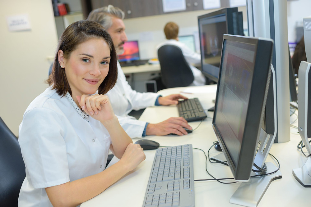 Medical Assistant at Computer
