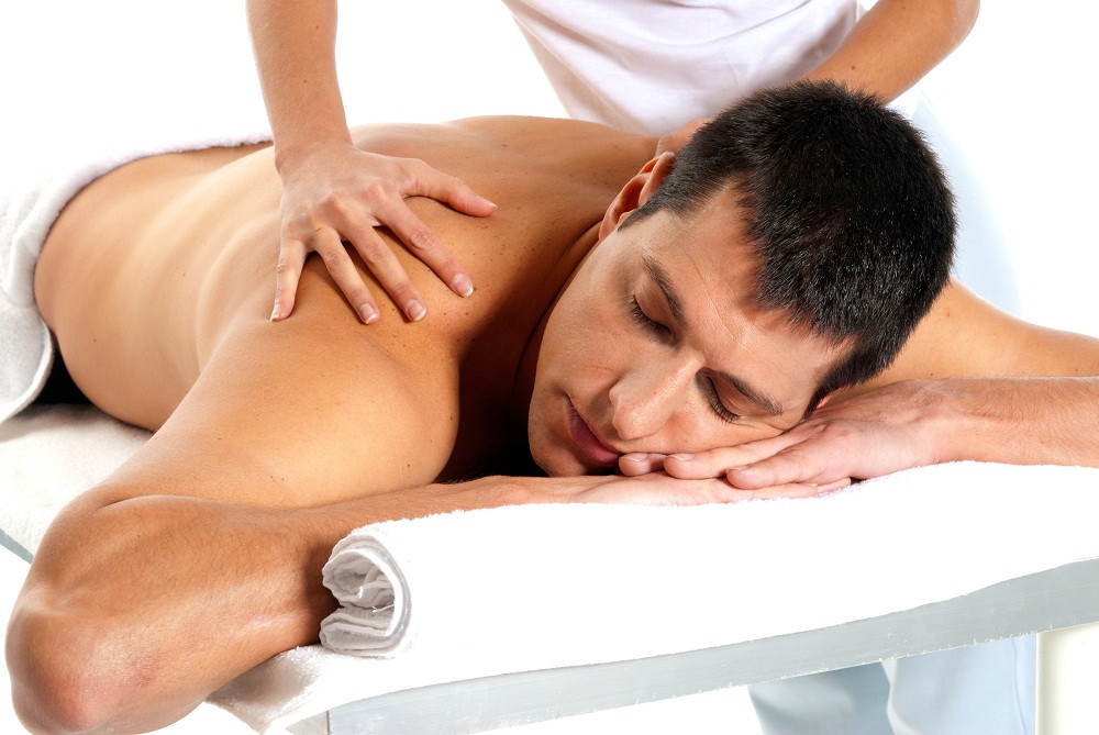 Man Receiving Massage by a student getting their massage therapy certification in Baltimore