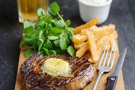 Rib eye steak with wasabi butter, chips,