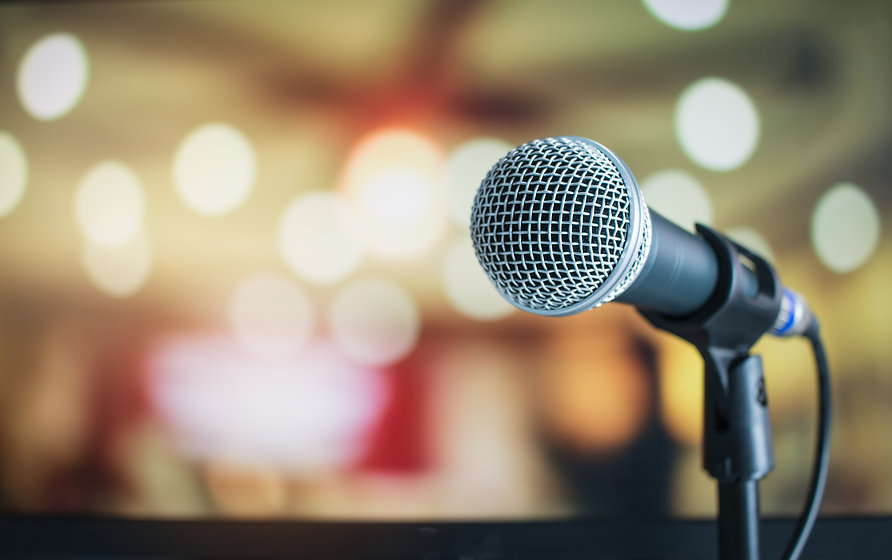 Microphone on abstract blurred of speech