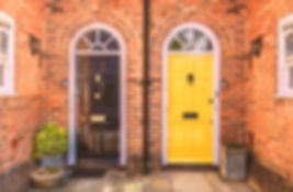 Two residential front doors, one yellow,