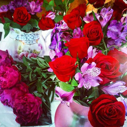 Working on red & purple floral arrangements for tomorrow's event! Love my job ❤💜❤ www.ElisaBrosiusE