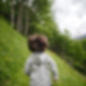 toddler-wearing-gray-hoodie-running-on-g