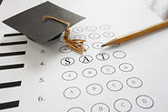 SAT test with pencil and mortar board gr