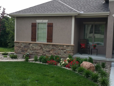 Front of home retaining wall and landsca