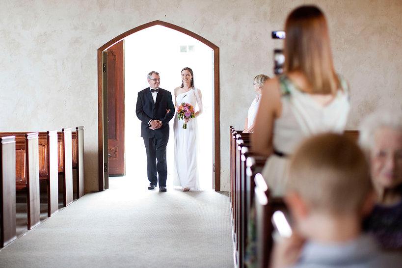 Bride walking down the aisle at Stones chapel, Yarra Valley