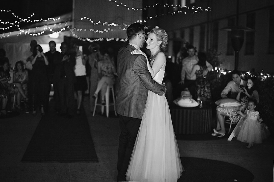 Wedding photos of dancing under the stars, fairy lights