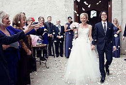 bride and groom walking down the aisle with confetti at Stones of the Yarra Valley