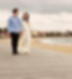 wedding photo of bride and groom walking along st kilda beach Melbourne