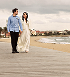wedding photo of bride and groom walking along st kilda beach Melbourne