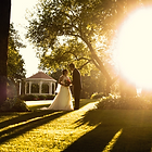 bride and groom in garden after ceremony with sun setting in Melbourne Australia