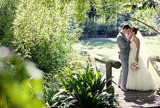 bride and groom in sunlight in Fitzroy Gardens Wedding in Melbourne