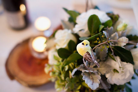 unique wedding center pieces, flowers, roses and hydrangeas with birds and wood