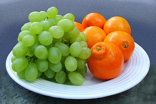 Green grapes and oranges