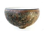 Thrown bell bowl. Matt white inside, lava lace out