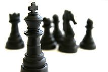 Lawyer playing with Black Chess Pieces