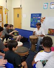 Sam teaching a music class