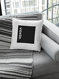 square-pillow-mockup-featuring-a-grey-fa
