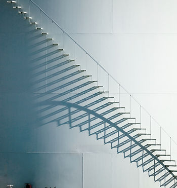 white-staircase-and-shadow-on-oil-storag
