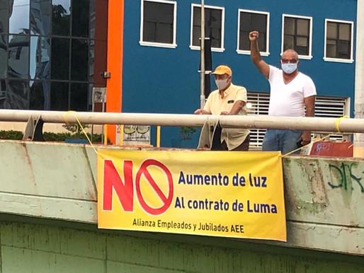 Empleados de AEE invaden puentes en contra del aumento de luz y del contrato de Luma Energy