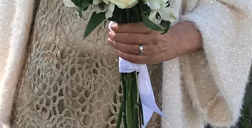 Elegant bridal bouquet with seasonal creams