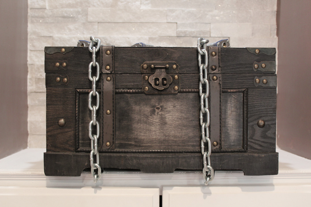Wooden chest with chains
