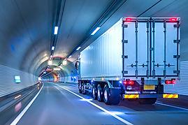 Canva - Trucks passing through tunnels_E