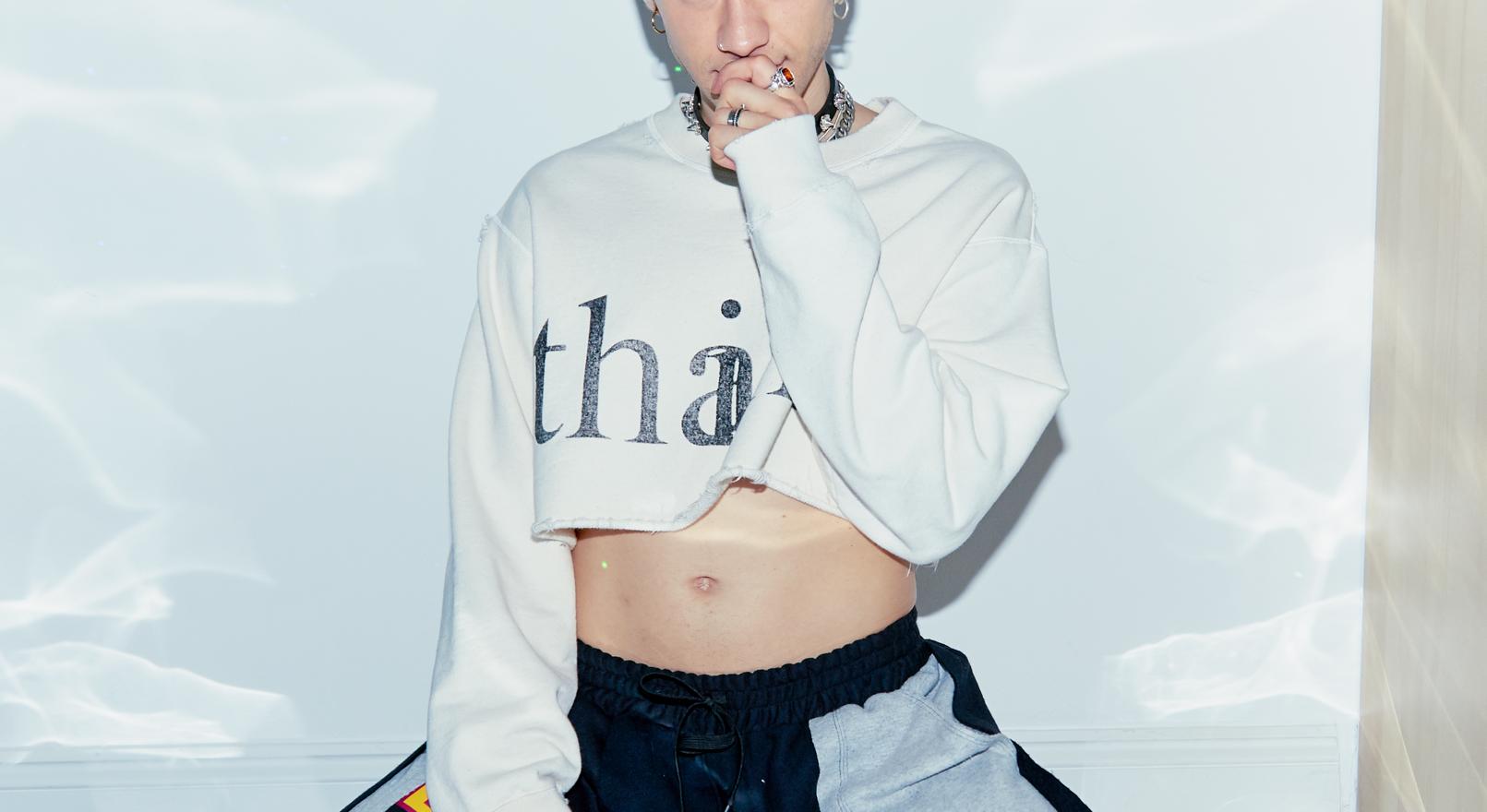 Olly Alexander wears rings by tinkershack