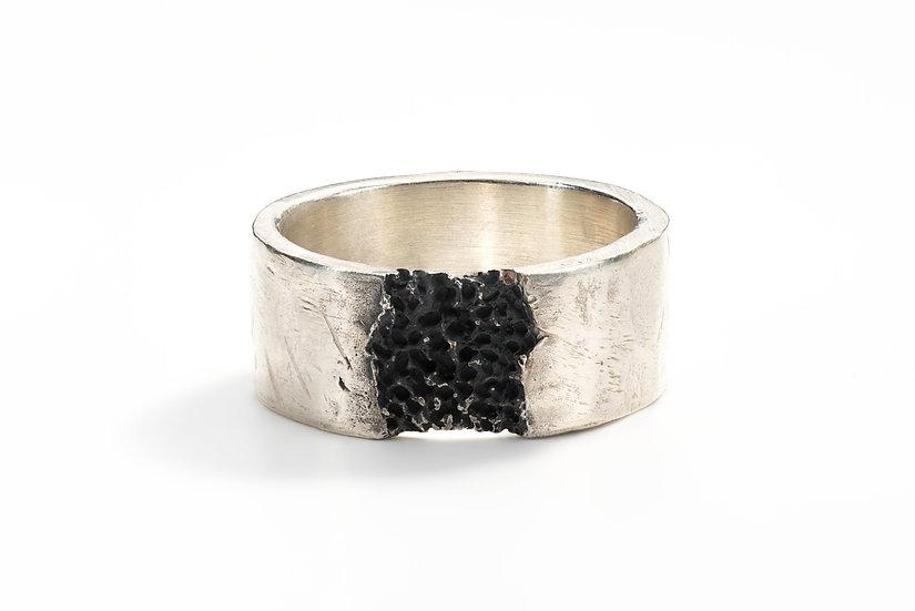 Eroded flat ring band