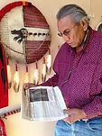 Chief Arvol Looking Horse with GOAL newspaper to save sacred grizzly bears
