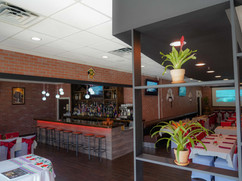 From waiting area, inning room + Bar