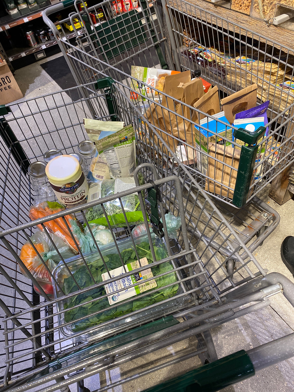 Two shopping carts with vegan groceries