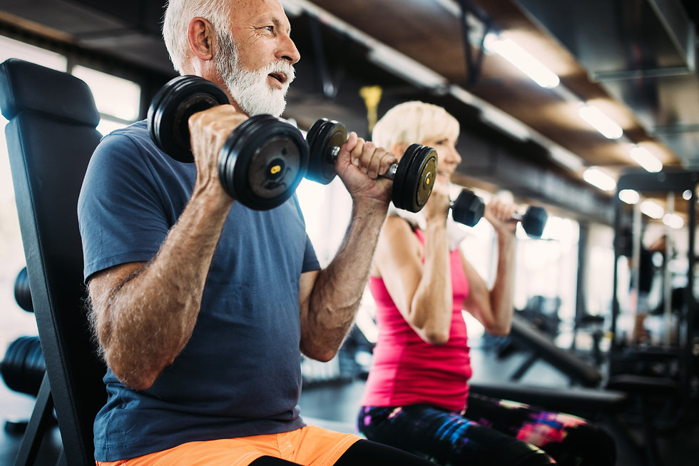 photodune-23050771-senior-fit-man-and-woman-doing-exercises-in-gym-to-stay-healthy-xl.jpg