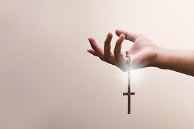 praying-hands-hold-crucifix-cross-metal-