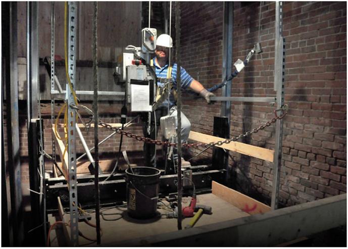 Elevator mechanic working on an elevator shaft