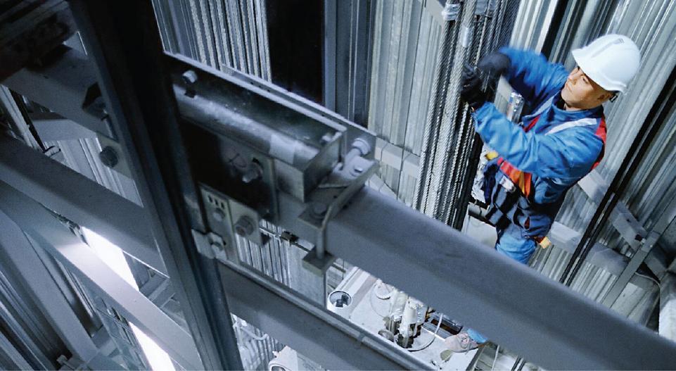 Mechanic working on elevator maintenance