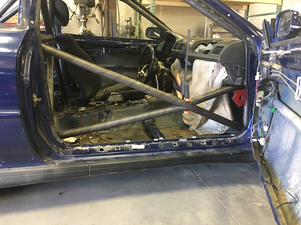 Doors cut to fit bars.  Willis Fab Worx roll cage. Tyro Racing a racing team.