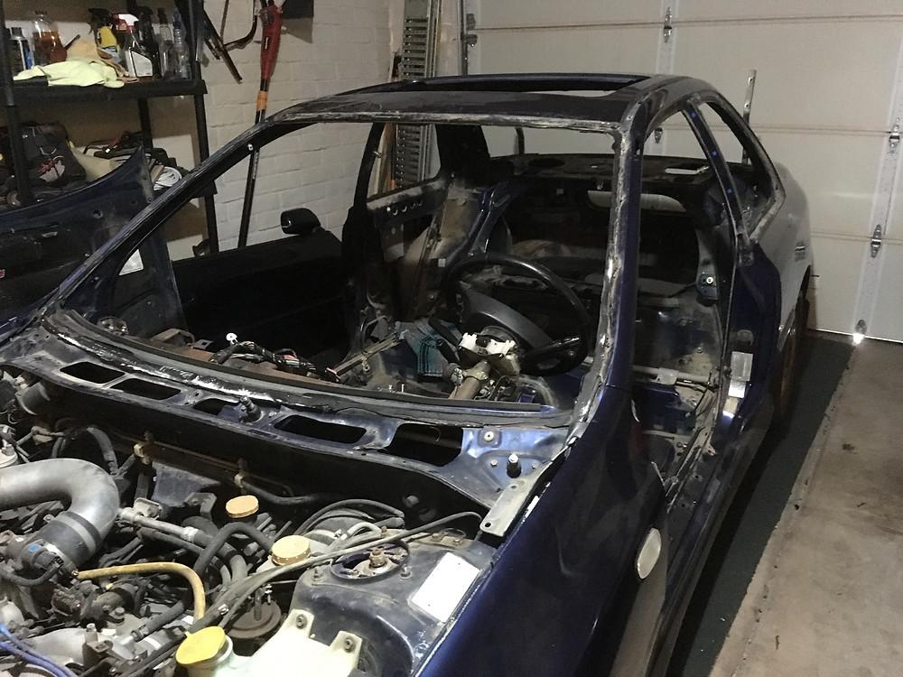 Windshield out Subaru 2.5RS. tyro racing a racing team.