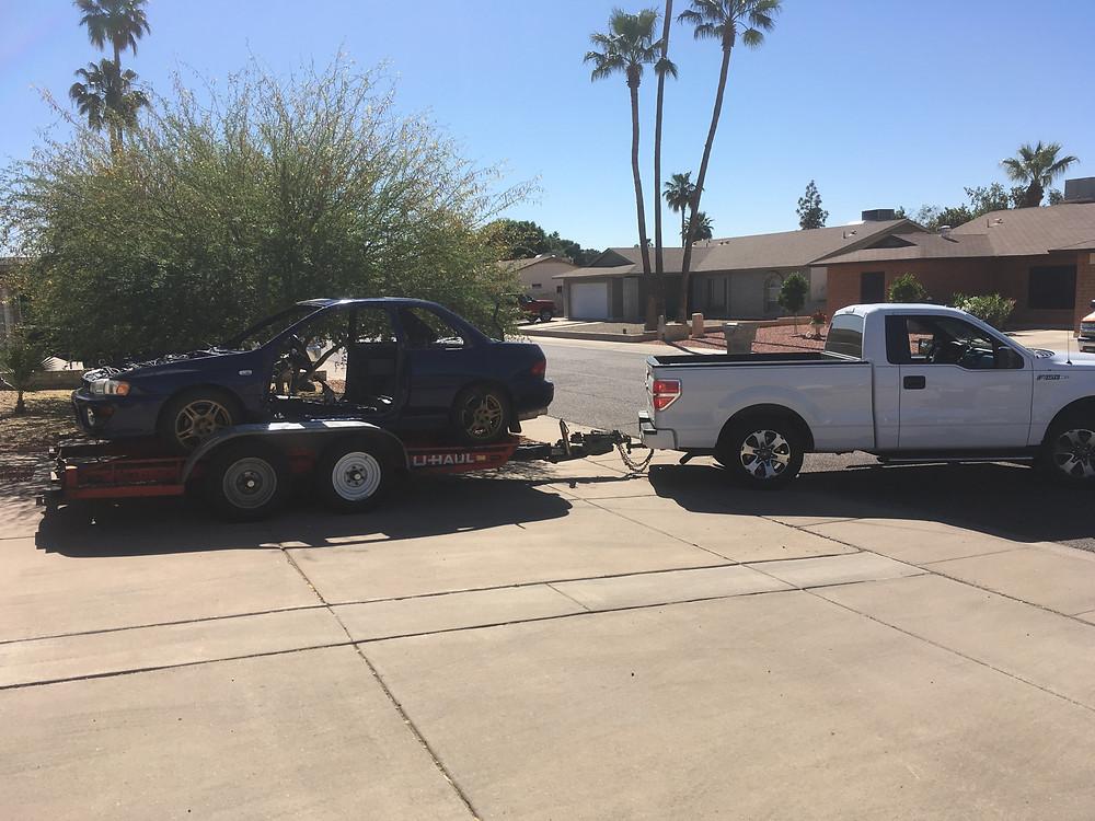 moving the shell of the Subaru 2.5RS. tyro racing a racing team.